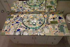 http://www.mosaicartsupply.com/mosaic-backsplash.aspx#   Melanie Berry in Baltimore made this mosaic countertop with very calming colors and cobalt accents that make use of patterned china shards.