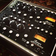 Custom Rane MP24s modified with analog VU meter,  rotary faders & Bozure isolator
