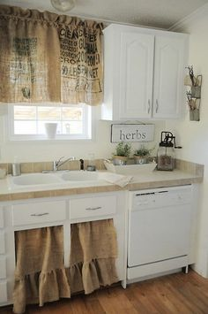 (THis is the design of our sink cabinet - have to think about a double skirt ) Love those Burlap Curtains and the Sink Skirt. Cute and Vintage I don't like writing on it and I would ad some color or white
