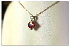 100% pure silver pendant and Sterling bale holding a 3.33ct Princess CZ Garnet. Hand-made with love by me!