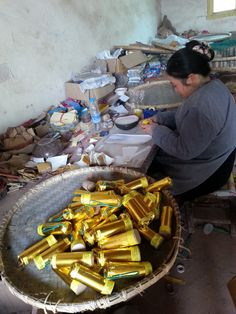 Dunpai fireworks factory workers packing reloadable Artillery with assortment.