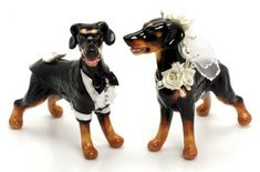 The cake toppers come in a variety of breeds. #wedding #doglover #dogthemedwedding #weddingcake #weddingideas