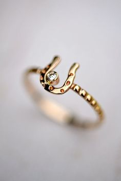14kt Gold Horseshoe Ring Moissanite by LaraLewis on Etsy. Finally a horseshoe that isn't on a necklace.
