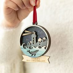 A Personalised Luxury Winter Christmas Decoration, complete with intricate festive scene and engraved banner wording of your choice.Featuring a majestic whale motif and traditional Christmas lighthouse to create a nautical scene, create a uniq. Christmas Tree Baubles, Winter Christmas, Christmas Crafts, Christmas Decorations, Laser Cutter Ideas, Laser Cutter Projects, Wood Laser Ideas, Laser Cut Wood, Gravure Laser
