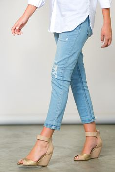 Love these casual cropped denim jeans!  Such effortless style! Gorgeous light blue wash with a chic distressed look. whiteplum.com #whiteplum #sp