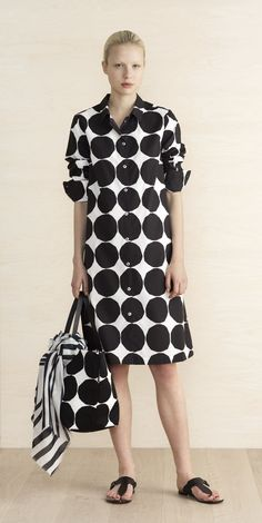 """MARIMEKKO MAILILL DRESS -  BLACK, WHITE    A lightweight shirtdress made of cotton poplin featuring the Pienet Kivet (Small Stones) print. It has a slightly flared cut to the knee-length hemline and comes with an optional matching belt. Metal buttons secure the front closure and cuffs; there are side slit pockets.  A size 38"""" measures 41.5"""" from the shoulder seam to the hemline.  Material: 100 % Cotton  #kivet #pirkkoseattle #pirkkofinland #seattle #matisse #shirtdress #dress #cuff…"""