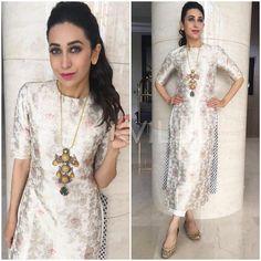 Karisma Kapoor celebrated Onam in Kochi, earlier today. Her choice of outfit was a white silk kurta from Raw Mango that she styled with a statement. Designer Salwar Kameez, Indian Salwar Kameez, Churidar, Anarkali, Designer Sarees, Lehenga Choli, Benarasi Dupatta, Designer Dresses, Banarasi Suit