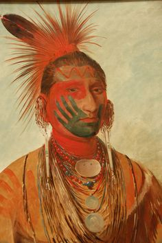 Catlin, George (1796-1872) Title: Portrait of Indian leader 'Shon-ta-ye-ga' (Little Wolf), frightening war 1845-46.Peintures to impress their opponents or show martial prowess (or a red hand black on the face to show the warrior had killed an enemy). You could also bear the marks of his clan (a wolf's footprint for the Wolf Clan). The paintings were made from fat, and vegetable dye, mineral or animal.