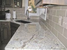Granite countertop and tile backsplash in kitchen remodel | Angie's List