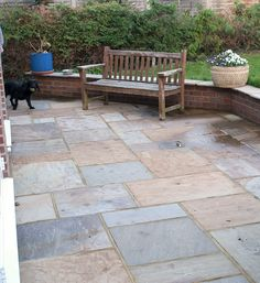 Create an attractive outdoor area with sandstone paving. Shown here: Saxon Swirl sandstone