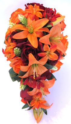 1 Bride's Cascade bouquet wide by long). 1 Maid of Honor Round bouquet ( round ). One Orange Lily, Burgundy Organza bows. One Orange open Rose, Wine Freesia accent, Burgundy Organza bow. Burlap Wedding Centerpieces, Fall Wedding Bouquets, Bride Bouquets, Flower Centerpieces, Centerpiece Ideas, Bridal Bouquet Fall, Wedding Arrangements, Flower Bouquets, Table Arrangements