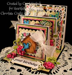 Heartfelt Creations Triple Easel Card by Gingerbeary8 - Cards and Paper Crafts at Splitcoaststampers    I have a bird house stamp and the square nestabilities. I love all the layers on this greeting card. Not sure I would spend the time to do all of the layers but I love what was created and this is a great inspiration.