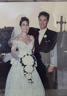Wedding Inspiration: In Tom Hanks marries Rita Wilson in a long floral dress but she changes into a mini skirt after the church ceremony. Tom and Rita are still happily married today. ==>>Learn about Wedding Trends in the & at Peppermint Twist Vintage Celebrity Wedding Photos, Celebrity Wedding Dresses, Celebrity Couples, Celebrity Weddings, 1980s Wedding, Star Wedding, Wedding Bride, Wedding Gowns, Hollywood Couples