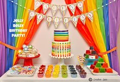 Una preciosa mesa de dulces para una fiesta arcoiris - me encantan las cortinas! / A lovely sweet table for a rainbow party - I love the curtains!