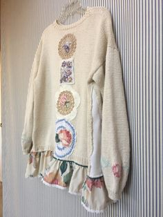 Upcycled Wearable Art, Cozy Sweater Trimmed with a Shabby Chic Ruffle Vintage Hand Knit thick Chunky sweater Tunic. I added Appliqué Roses and Crochet Doilies to the back. Size is Approximate, medium- Measured laying flat 20 across armpit to armpit 29 long 25 across hips