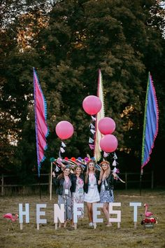 Girls behind Henfest letters with balloons and festival flags Festival Themed Party, Festival Wedding, Boho Festival, Boho Hen Party, Hens Party Themes, Party Dares, We Are Festival, Bachelorette Party Decorations, Festival Decorations