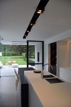 The black accents are nice. House VGL Belgium by vlj-architecten - Kitchen Interior Modern, Interior Design Kitchen, Interior Architecture, Kitchen Decor, Küchen Design, House Design, Design Trends, Minimalist Kitchen, Home Kitchens