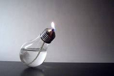 Oyule is an oil lamp that takes the shape of a light bulb by designer Sergio Silva Creative Design, Modern Design, Web Design, Modern Contemporary, Old Lights, Incandescent Light Bulb, Lamp Sets, Ceramic Cups, Alcohol