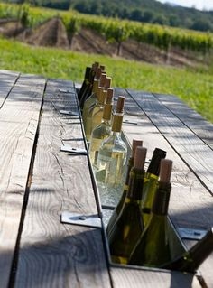 Too clever! Remove center board of a picnic table and replace with a gutter. Fill with ice for an instant beer and wine chiller!