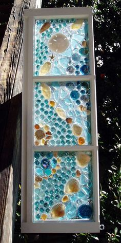 50 diy projects with mosaic do it yourself ideas and projects this garden glass window is called mosaic shells aqua solutioingenieria Gallery