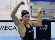 Dana Vollmer of the U.S. reacts after she set a world record, winning the women's 100m butterfly final.