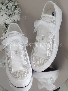 Stunning elegant mono white Converse with embellished toes, eyelet panels and backs and finished with sheer white ribbon laces. A perfect bridal shoe or just for feeling very special. These are available in UK sizes 3-8 including half sizes. They are also available in junior sizes