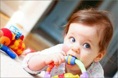 With baby teething symptoms showing days before each baby tooth, that's a lot of cranky days and nights. Here are 11 baby teething remedies to help soothe your baby's pain. Baby Teething Remedies, Teething Symptoms, Baby Massage, Hydrogen Peroxide Magic, Baby Toys, Kids Toys, Best Parenting Books, Teething Toys, Teething Signs