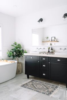 An incredible before and after. Today, I'm revealing the master bathroom design and all the products and finishes we chose. It's our modern black and white bathroom!