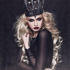Dark Queen - We jump at any opportunityto don a crown and be a queen for the day. Wear a dark shade of red lipstick and create a dramatic smoky eye. Create a high brow arc using aneyebrow pencil.Style It With: A black dress, piles of silver jewelry, and, if the crown fits, wear it.@halloweenmakeupideas
