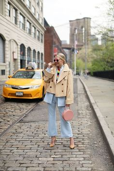 Blair Eadie wears a pale blue suit with a cropped trench and striped sweater // Click through to Atlantic-Pacific for more casual suiting looks Baby Blue Pants, Nyc Spring, Fashion Tips For Women, Womens Fashion, Blair Eadie, Atlantic Pacific, Heart Shaped Sunglasses, Ootd, Cool Style
