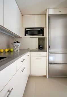 Kitchen Design Idea - Store Your Kitchen Appliances In A Dedicated Appliance Garage // The sliding doors of this appliance garage open to reveal a spacious hiding spot just the right size for the most frequently used appliances. Kitchen Appliance Storage, Appliance Garage, Kitchen Cabinets And Cupboards, Kitchen Cabinet Doors, Modern Cabinets, Dark Cabinets, Minimal Kitchen, Basic Kitchen, Updated Kitchen