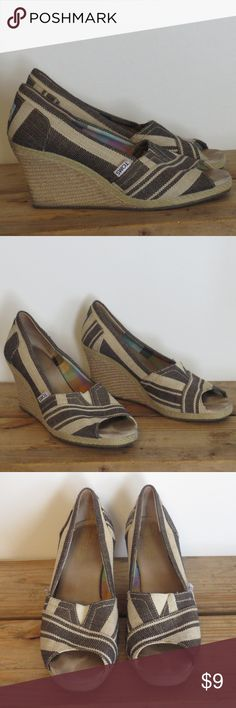 Toms Canvas Tan & Brown Wedge Heels Sz 8.5 W Toms Canvas Tan & Brown Wedge Heels Size 8.5 W They do show wear as indicated in photos Like other items in my closet?  Make a bundle and I'll send my best offer! Know what else is great about bundling?  Poshmark only charges shipping for one item, no matter how many items you bundle! TOMS Shoes Heels