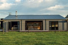 Large opening on three sides of the house lend the structure a lightweight feel.