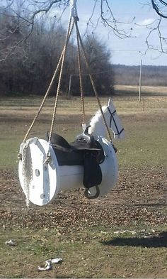 This is a swing, but along that same line, one of these would make an easy saddle rack (kids playset outdoor diy)