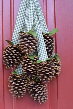 LOVE these sweet little pinecones hanging from gingham ribbons! Such an easy DIY home decor idea for our kitchen hutch