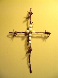 Barbwire cross with pearls.  What a beautiful reminder of the beautiful gift we are given and the price that was paid.