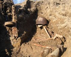 Russian soldier still has his helmet on his head, a rusty ppsh and a boot, place unknown.