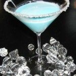 Silent Night Martini!: 1/4 c. Malibu Rum, 1/4 c. pineapple juice, 1/8 c. blue curacao, 1/8 c. white creme de coacoa, dash or two of whipping cream~ rim a martini glass with sugar, add all ingredients with ice- shake and pour! I'm DYING.