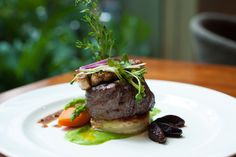 Grilled Beef AUS Tenderloin with Foie Gras, served with minced green pea, potatoes, and apple in green pepper sauce.