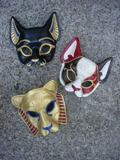 Egyptian cat masks - Bast (Bastet...Egyptian goddess of music, fertility and the Dance), a new Venetian cat, and Sekmeht (Egyptian goddess of war).
