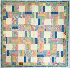 1930's Reproduction Fabrics were used in this lap quilt.