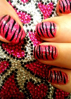 Flashy Pink Zebra Nails - Directions: 1. Glittery Pink Nail Polish Base 2. Using a nail art pen, swipe zebra stripes on. 3. Apply topcoat.