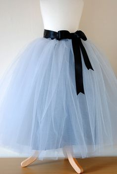 This sewn classic romantic tutu skirt has two parts: the bottom tutu is fully lined in circle satin skirt with invisible zipper at the back and few