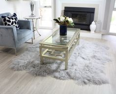 Real shaggy fur area floor rugs designed and hand crafted in Australia from premium Tibetan Mongolian sheepskin. Light grey large octo design.