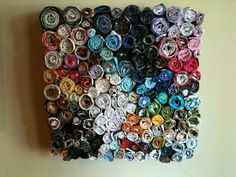 Wall art made from rolled up magazine pages and glued to cardboard.