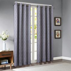 The Paige Window Panel by Madison Park will bring a pop of color and dimension to your space. This gorgeous jacquard panel features a geometric pattern that showcases layers of diamonds in a white and rich navy blue color palette. The window panel includes a grommet top finish, making movement and draping of the window panels seamless.