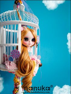 Nanuka - Custom Blythe. I love the idea of a birdcage as a doll room! Very clever.