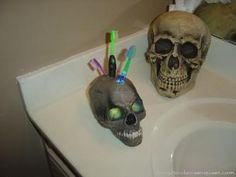 "Skull Toothbrush Holder: drill 3 holes with a 5/8"" spade bit in a plastic skull."