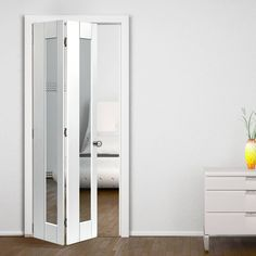 The Calypso Tobago White Primed Bi-fold Door is supplied with a track at the top and a pivot bracket at the side at the bottom. White Bifold Doors, Door Design, Bifold Closet Doors, Doors Repurposed, Bathroom Makeover, Space Saving Doors, Room Doors, Bathroom Doors, Bathrooms Remodel