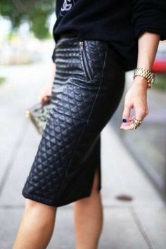 Womens Street style fashion: black quilted leather skirt